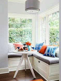 A window seat is a seating area in an alcove or nook that is lined with windows. There are several ways to create a corner window seat. Corner Window Seats, Corner Seating, Corner Bench, Corner Banquette, Corner Nook, Corner Windows, Banquette Bench, Kitchen Banquette, Corner Space