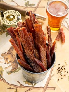 Smoked Salmon Jerky: A protein-rich snack that's fit for a king! Grade A wild Alaskan king salmon is first caught in the icy cold waters off Alaska's coast, and then filleted by hand into generously sized strips and carefully seasoned, and lastly smoked in small batches over natural cherry and alderwood chips for 24 hours to yield the most tender jerky you've ever tasted.