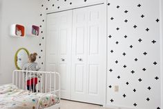 Love the all white room with one wall that has pattern