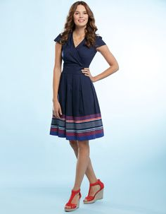 This style dress is good for me. Sophia Dress in Navy by Pepperberry - A best-selling shape with full pleated skirt, statement printed hem and side zip fastening