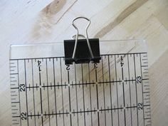 A paper clip is such a smart idea for hanging rulers that don't have a hole. Other ideas for storing quilt rulers as well.