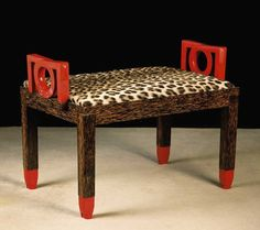 Art Deco stool with red lacquer and leopard fur seat.