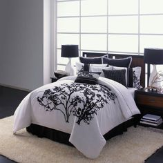 Bring tranquil elegance to your bedroom decor with this Adrien Lewis Berlin five-piece embroidered comforter set. The comforter displays embroidered trees, which are echoed throughout the shams and accent pieces.