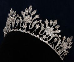 """Large traditional tiara 2 1/2"""", Marquise cut rhinestones across top. Easy menu navigation so that you can find the PERFECT item! Our mission is to provide the widest variety of the most unique & high quality wedding and event favors and accessories available, and to provide at the absolute lowest price on the web. 