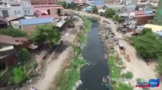 Canals in the Cambodian capital Phnom Penh are heavily polluted and overrun with garbage. Rough Cut (no reporter narration).