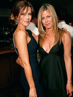 Kate Beckinsale cozies up to Jennifer Aniston Tuesday at a bash hosted by the Wanderlust star and Self magazine for trainer Mandy Ingber's new book, Yogalosophy, in Los Angeles.