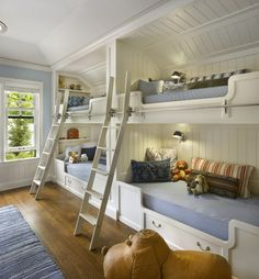 Amazing Built-in Bunk Beds. I like the sleeping on one wall, media on one wall & sitting area in the middle.