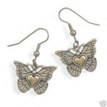 """These brand new butterfly french wire earrings are part of our """"Heart of Gold"""" collection and they are solid genuine .925 sterling silver featuring a 14 karat gold """"Heart of Gold"""" center."""