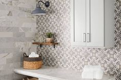 Inspired by real cement-encaustic tiles, this porcelain tile combines geometric shapes and neutral tones in an easy-to-care-for, durable tile. Paired with a classic marble subway tile creates a fresh and lively design!  #thetileshop #patternedtile #marbletile #subwaytile #laundryroom