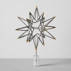 Add the perfect finishing touch to your festive holiday tree with the Moravian Star Tree Topper from Hearth & Hand™ with Magnolia. Crafted from iron to keep it durable enough to reuse year after year, this tree topper comes in a sleek silver tone with gold-finished points so it'll shine brightly as your tree's beautiful focal point.<br><br>Celebrate the everyday with Hearth & Hand — created exclusively for Target in collaboration with Magnolia, a...