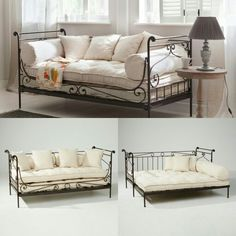 Wrought iron daybed with cushions.