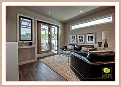 Home staging ideas. We used a large cream rug in this room to give it a warm, cozy feel. The cream color complements the dark espresso color in the hardwood and furniture.