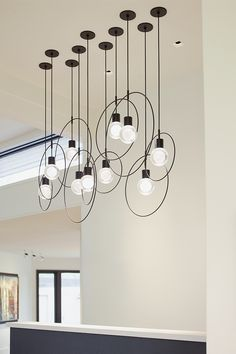 The Locus pendant light accessory from Tech Lighting is a clean, circular accessory adds dimension and scale as it frames simple socket and cord style pendants such as the SoCo, Alva and Mina pendant lights.