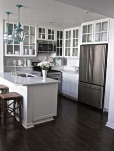 Beautiful White Cabinets With Dark Floor, Glass Cabinet Doors Open Up Small Kitchen