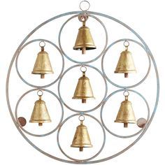 Inspired by ancient design and created with ceremony in mind, our iron wall decor features seven gold-tone bells surrounded by a circular frame to create a bright, warming atmosphere indoors and out.