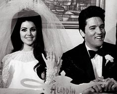 Priscilla and Elvis on their wedding day, May 1967. I totally want big 'Cilla hair.