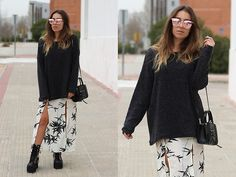 Get this look: http://lb.nu/look/8624693  More looks by Claudia Villanueva: http://lb.nu/ctrendencies  Items in this look:  Trendencies Store Sunglasses, Primark Sweater, H&M Bag, Zaful Skirt, Sheinside Boots   #bohemian #casual #chic #outfit #sping #midiskirt #floralprint #combatboots #trends