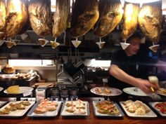 The pintxos bar at La Cepa (look at those jamóns!) - photo by @afickledream_