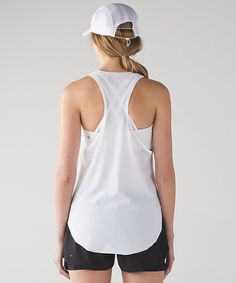 Work Out To Water Tank in white - Layer this lightweight tank on over your favourite sports bra or swimsuit and you're set to sweat.  Fabric is sweat-wicking, four-way stretch and UPF 50+    added Lycra® fibre for stretch and shape retention