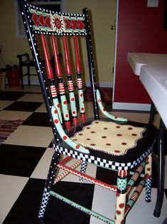 Salvaged roadside chair whimsically repainted. Find fabric and use as inspiration. Can also use fabric as a chair cushion.