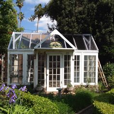 Greenhouses Made With Salvaged Windows Greenhouse made with recycled windows and doors Old Wood Windows, Recycled Windows, Windows And Doors, Antique Windows, Greenhouse Shed, Greenhouse Gardening, Old Window Greenhouse, Herb Gardening, Gardening Vegetables