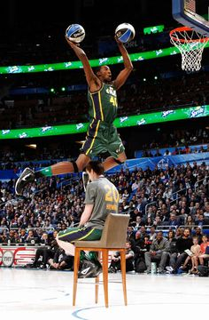 Utah Jazz's Jeremy Evans jumps over teammate Gordon Hayward during the NBA basketball All-Star Slam Dunk Contest in Orlando, Florida