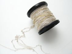 25 meter spool of tiny silver tone plated by thehoarderscloset, $13.99