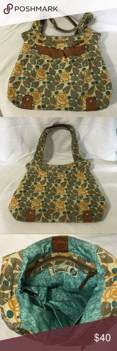 """Fossil canvas floral and leather hobo purse Awesome Fossil canvas floral hobo bag. Leather trim and leather handles. Excellent condition. No tears or stains. There is one tiny spot that I found and you can see it where my fingernail is pointing. Also a tiny bit of darkening on the bottom, but not much. Approximately 12""""tall and 16"""" wide. Fossil Bags Hobos"""