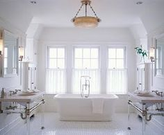 Inspiration photo for master bath.  I like how light and bright this is.  Our tub is going to be in a windowed bump out (bay).