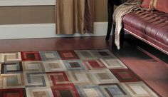 Brighten up your flooring with a 5'3'' x 7'2'' Radiance Area Rug. Featuring a beautiful blend of Brown, Red and Blue hues in a classic geometric pattern, this rug is an ideal addition to any room.