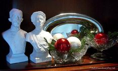 CreateChristmas memories with vignettes in unexpected spots like a shelf in the bookcase or secretary as shown here.