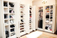 white walk-in closet with doors to conceal your wardrobe.
