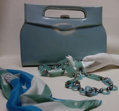 Andrea Pfister Leather Purse; YSL Silk Scarf; YSL Beaded necklace ...