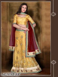 Be recognized as a Style Diva with this beautiful Beige Color Designer Lehenga Choli! The beautiful Zari Embroidery is done all through the Lehenga & the borders of the Top.