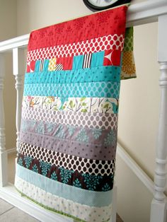 strip quilt. Maybe one day I'll actually do something like this. I LOVE it.