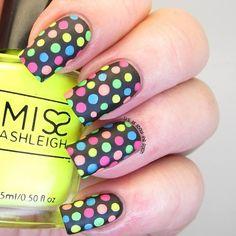 Rainbow polka dot art on black nails