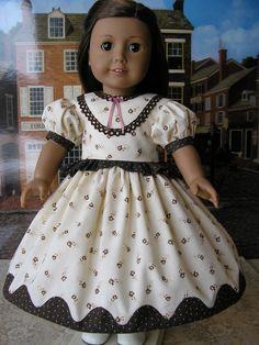 Mid-1800s dress with peplum and 'pie crust' appliqued hemline. $47.00, dolltimes via Etsy.