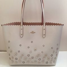 Coach Flower Aplique Tote Beautiful and perfect for summer tote with hnd applique flowers . Model: F37651. Made of crossgrain leather. Chalk color. Dual straps of about 11 drop. Open top. Interior: zip and open pockets, no linings. Coach Bags Totes