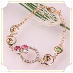 "Multicolor woman's gold filled Austrian bracelet. Multicolor woman 14K gold filled Austrian crystal 9"" bracelet. Beautiful different colored stones enhancing its beauty. Jewelry Bracelets"