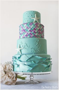 Whimsical Teal and Lavender Starfish Wedding Cake by The Pastry Studio: Daytona Beach, Fl