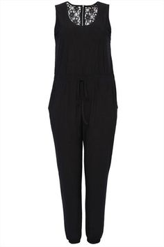 Plus size black sleeveless jumpsuit with a floral lace back and silver zip fastening. Has an elasticated waistband for easy fit with a fabric waist tie, two open pockets to the trousers and elasticated cuffs. Made in a soft silky stretch fabric, this jumpsuit can be worn with heels and a statement clutch for a night out. Available in size 14-26/28 Shop Here: http://www.stylishplus.com.au/collections/jumpsuits-1/products/black-sleeveless-jumpsuit-with-floral-lace-back-insert