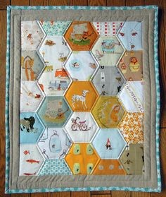 mini hexagon quilt with heather ross fabrics <3 Love the fabric, love the hexagon. Wish I could quilt.