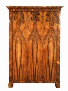 Biedermeier Vienna - Collection An elegant Biedermeier armoire. Bookmatched walnut veneer. Ebonized details. French polish finish. Austria, c. 1825 H: 80 inches, W: 51 inches, D: 22 1/2 inches