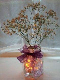 Purple gypsophila arrangement with submersible tea light.Use our white submersible tea light with this. http://www.bluedottrading.com/led-tea-lights/submersible-led-tea-lights.html