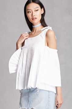 A woven open-shoulder top featuring a pleated bottom, long pleated bell sleeves, a round neckline, and self-ties at the shoulders. This is an independent brand and not a Forever 21 branded item.
