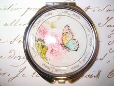 Compact Mirror with Butterfly cosmetic by RubysNeedfulGifts on Etsy.