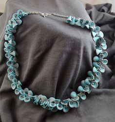 Elegant gray and turquoise petals necklace