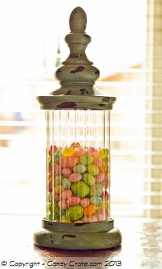 Mixed unwrapped Easter candy in a pretty apothecary jar makes a simple and sweet addition to any spring event!