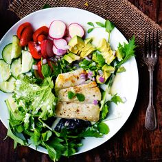 Lemon Buttermilk Dressing recipe on a gorgeous garden salad with chicken. It's got radishes, cucumbers and avocados...Seriously GOOD.
