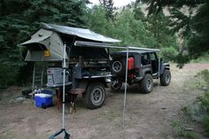 Jeep, offroad trailer, rooftop tent setup.